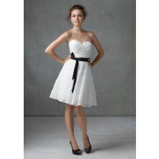 A line strapless knee length short white lace dress with black sash